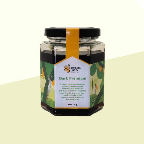 A beautiful dark liquid known as Dark Premium Honey in a medium size glass jar.